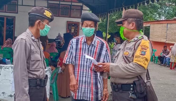 Polsek Rambutan Pantau Penyaluran BST ke Masyarakat Dari 2 Kelurahan